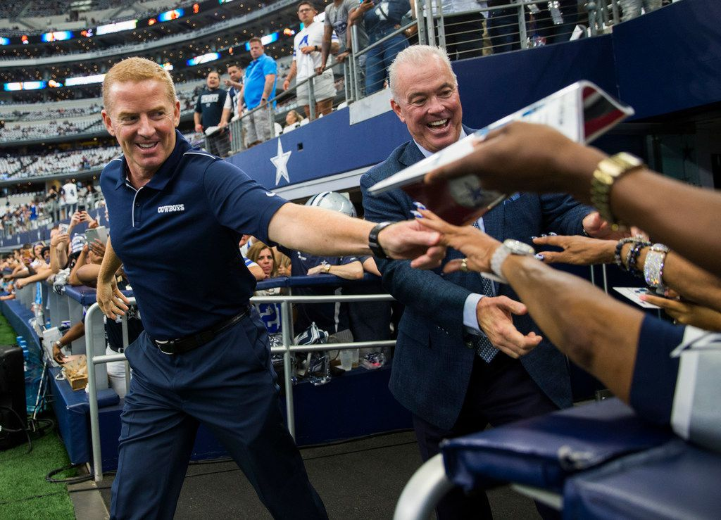 FILE - Jason Garrett and Cowboys VP Stephen Jones greet fans before a game between the Cowboys and New York Giants on Sunday, Sept. 8, 2019, at AT&T Stadium in Arlington.
