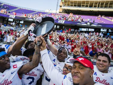 """Southern Methodist Mustangs celebrate a 41-38 win over TCU Horned Frogs by hoisting the """"Iron Skillet"""" on Saturday, September 21, 2019 at Amon G. Carter Stadium in Fort Worth."""