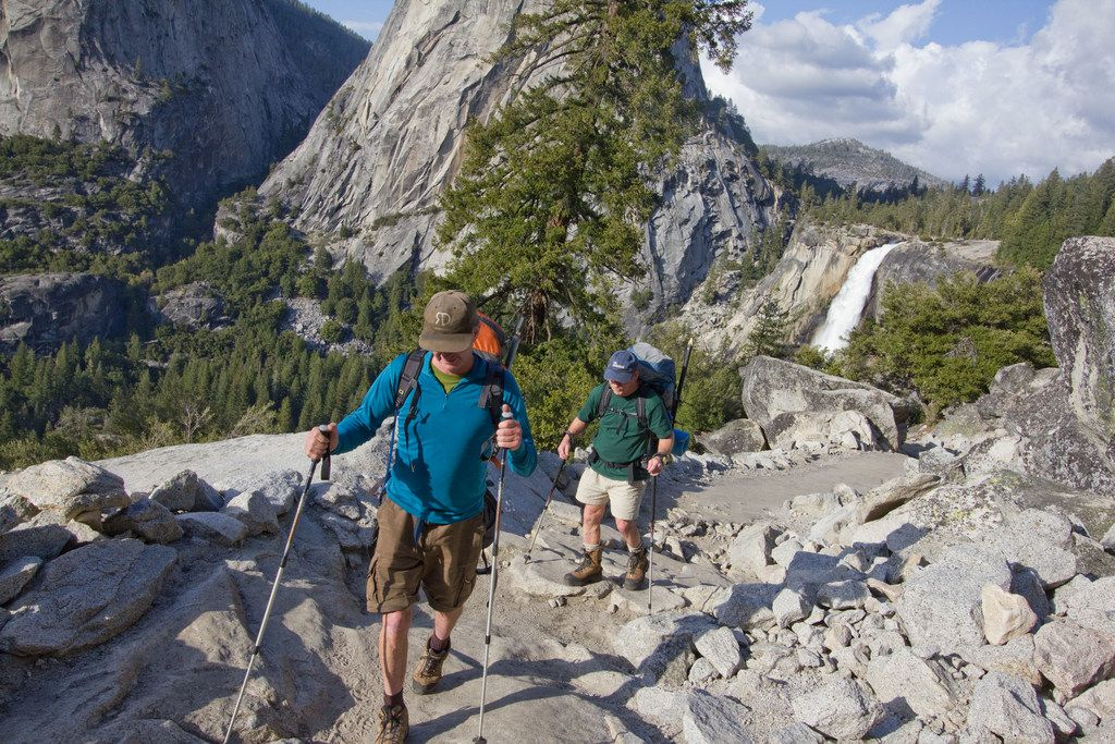 The John Muir Trail offers stunning views of iconic features in Yosemite National Park, including Nevada Fall and Liberty Cap.
