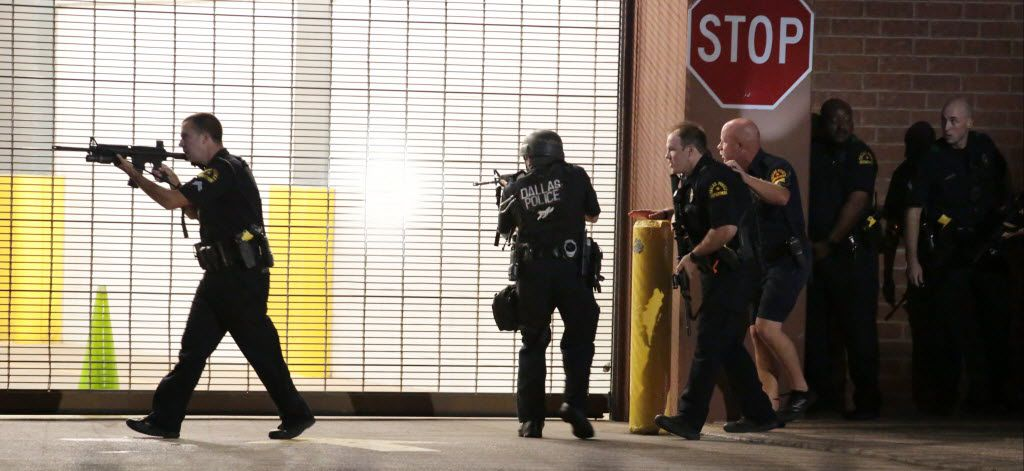 Dallas police respond after shots were fired during a protest over recent fatal shootings by police in Louisiana and Minnesota, Thursday, July 7, 2016, in Dallas. Snipers opened fire on police officers during protests; several officers were killed, police said. (Maria R. Olivas/The Dallas Morning News)