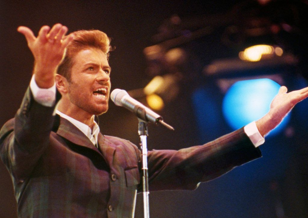 """In this Dec. 2, 1993 file photo, George Michael performs at """"Concert of Hope"""" to mark World AIDS Day at London's Wembley Arena."""