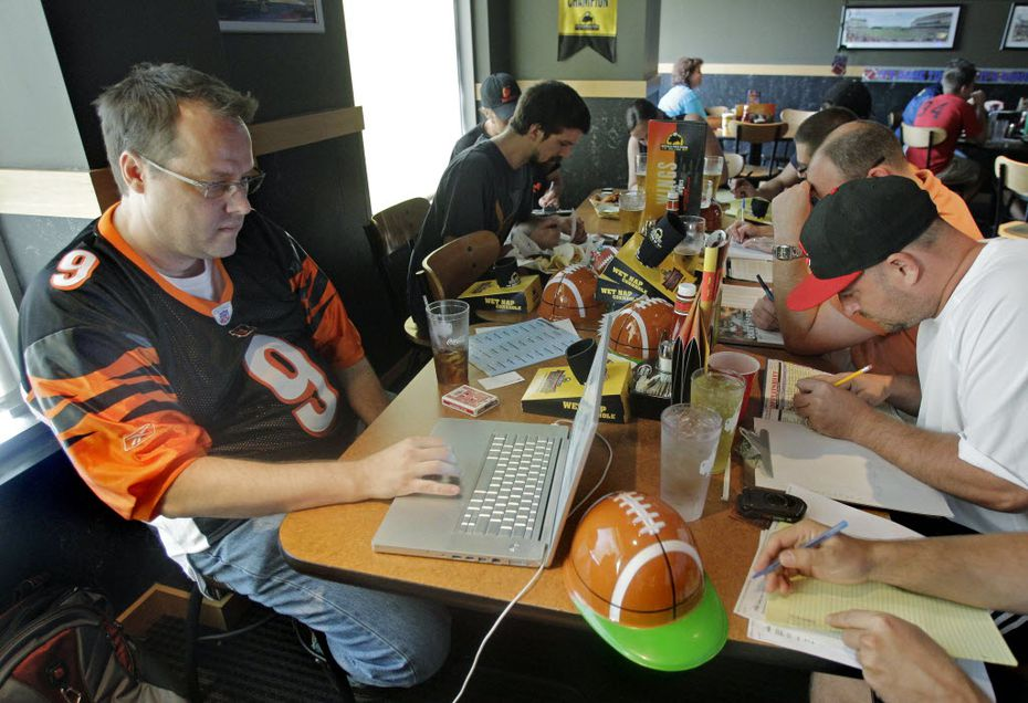 Brian Sherman, left, and his friends draft players to their fantasy football teams in 2010 at Buffalo Wild Wings.