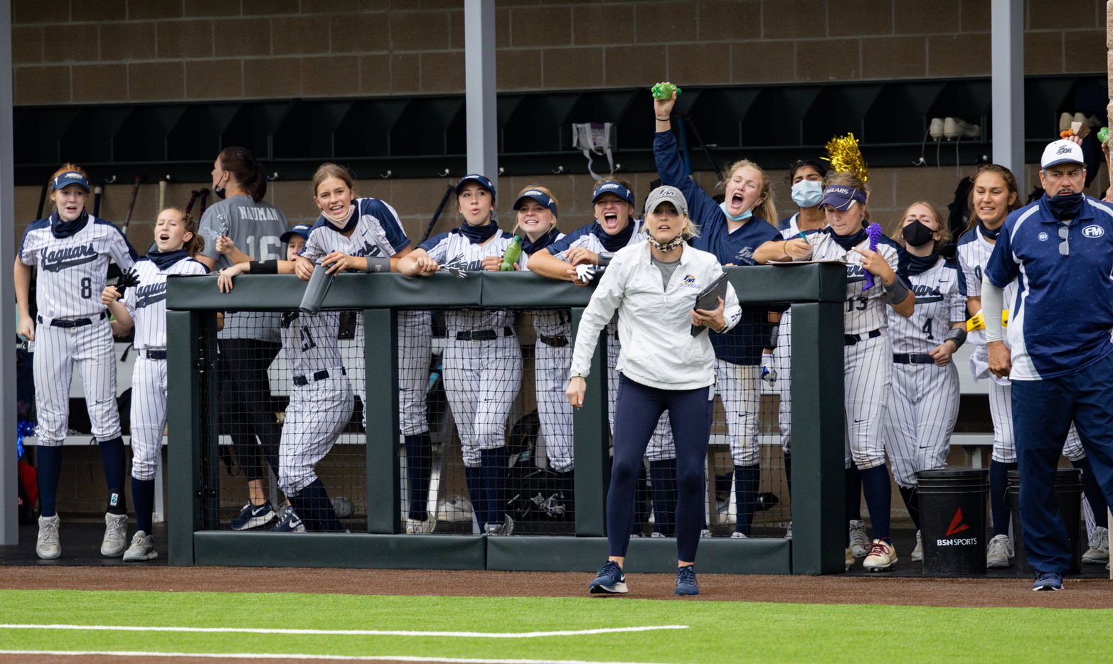 Flower Mound players cheer their team on during the second inning of a softball Class 6A bi-district playoff game against McKinney Boyd on Friday, April 30, 2021, in Denton. (Juan Figueroa/The Dallas Morning News)