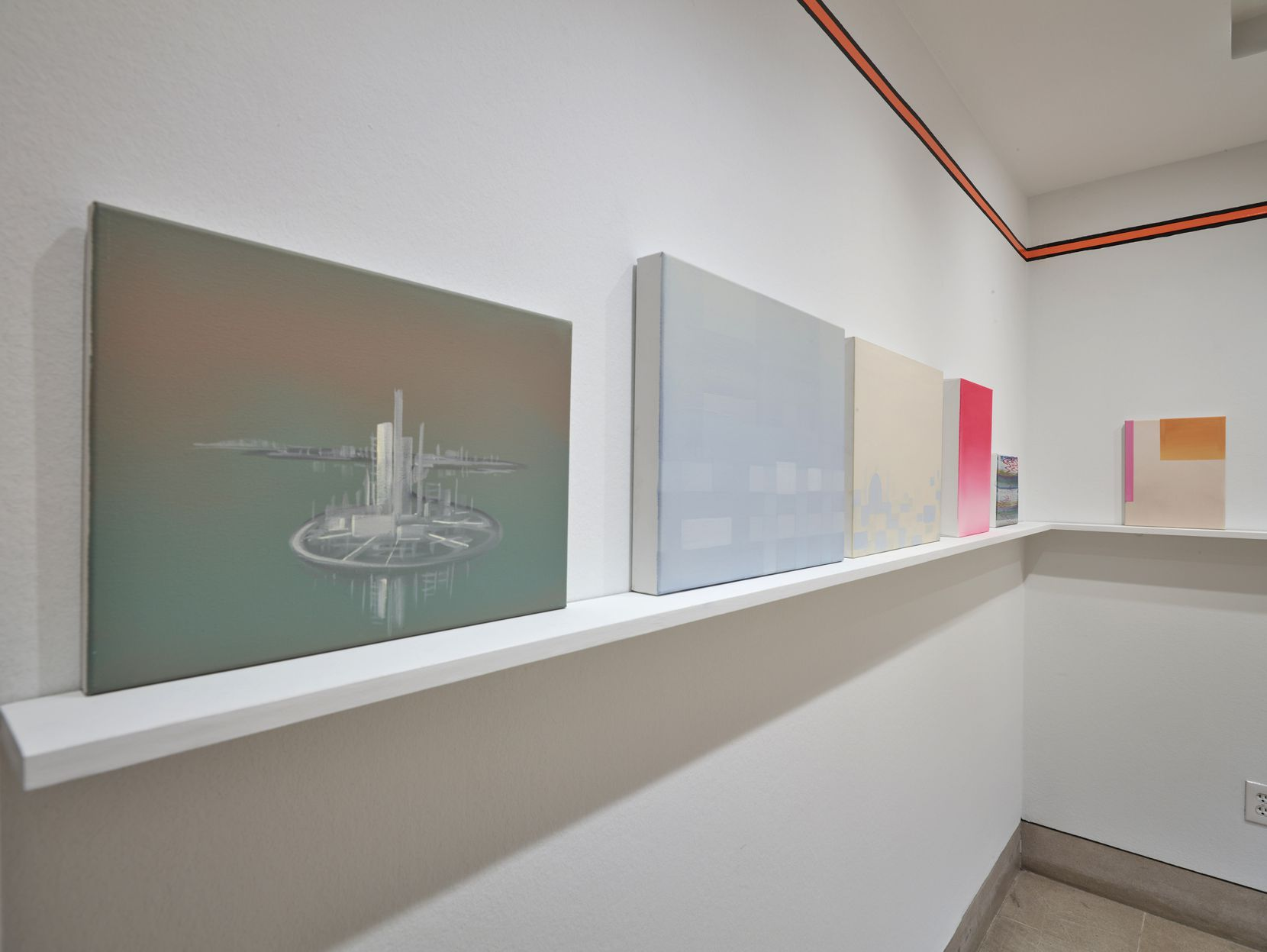 Before entering the main gallery, viewers pass through a smaller room that offers an introduction to Wanda Koop's work with 26 of her smaller, preparatory works perched on a shelf.