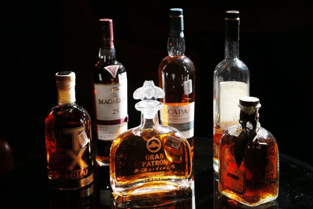 From L to R, TX Blended Whiskey, 25 years Macallan Single Highland Malt Scotch Whisky, Gran Patron Burdeos, Scapa Single Malt Scotch Whisky, George T. Stagg Bourbon Whiskey and Pyrat Rum at the Library Bar at the Warwick Melrose Hotel in Dallas, TX on February 3, 2015.