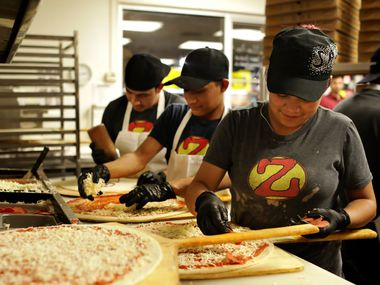 Employees prepare a steady flow of pizzas during a 2 a.m. rush at Zalat Pizza on Fitzhugh Avenue in Dallas. It's the busiest Zalat so far, but its general manager hopes a coming-soon restaurant in Denton gives it a run.