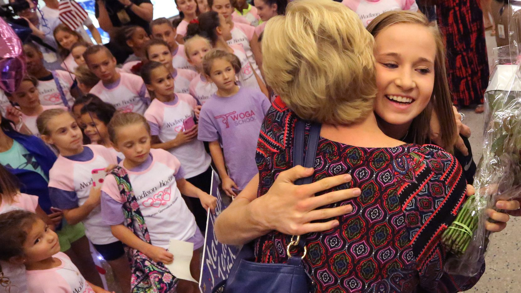 Dallas Olympian Maddie Kocian was greeted by a contingent from the local World Olympic Gymnastics Academy at DFW Airport on Wednesday as she returned home after competing in the Summer Olympics in Rio de Janeiro.  (Louis DeLuca/Staff Photographer)