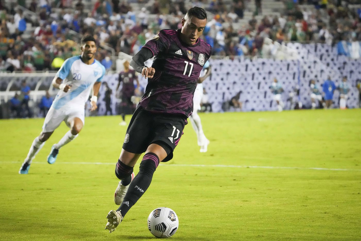Mexico forward Rogelio Funes Mori controls the ball during the second half of a CONCACAF Gold Cup Group A soccer match against Guatemala at the Cotton Bowl on Wednesday, July 14, 2021, in Dallas.