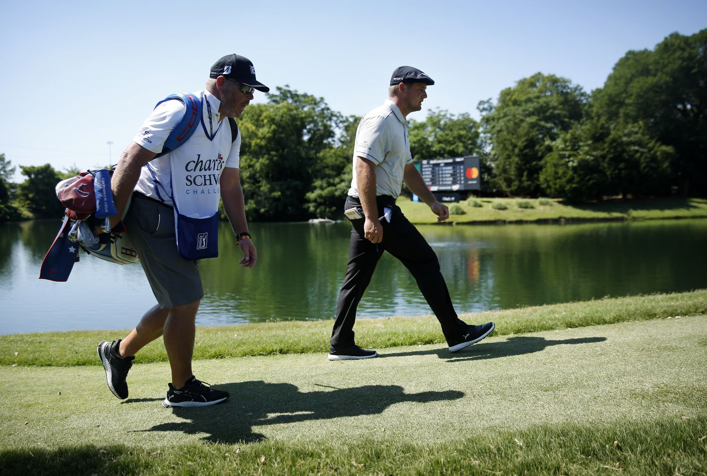 PGA Tour golfer Bryson DeChambeau and his caddie Tim Tucker walk back up the par-3, No. 13 during his third round of the Charles Schwab Challenge at the Colonial Country Club in Fort Worth, Saturday, June 13, 2020.  The Challenge is the first tour event since the COVID-19 pandemic began. (Tom Fox/The Dallas Morning News)