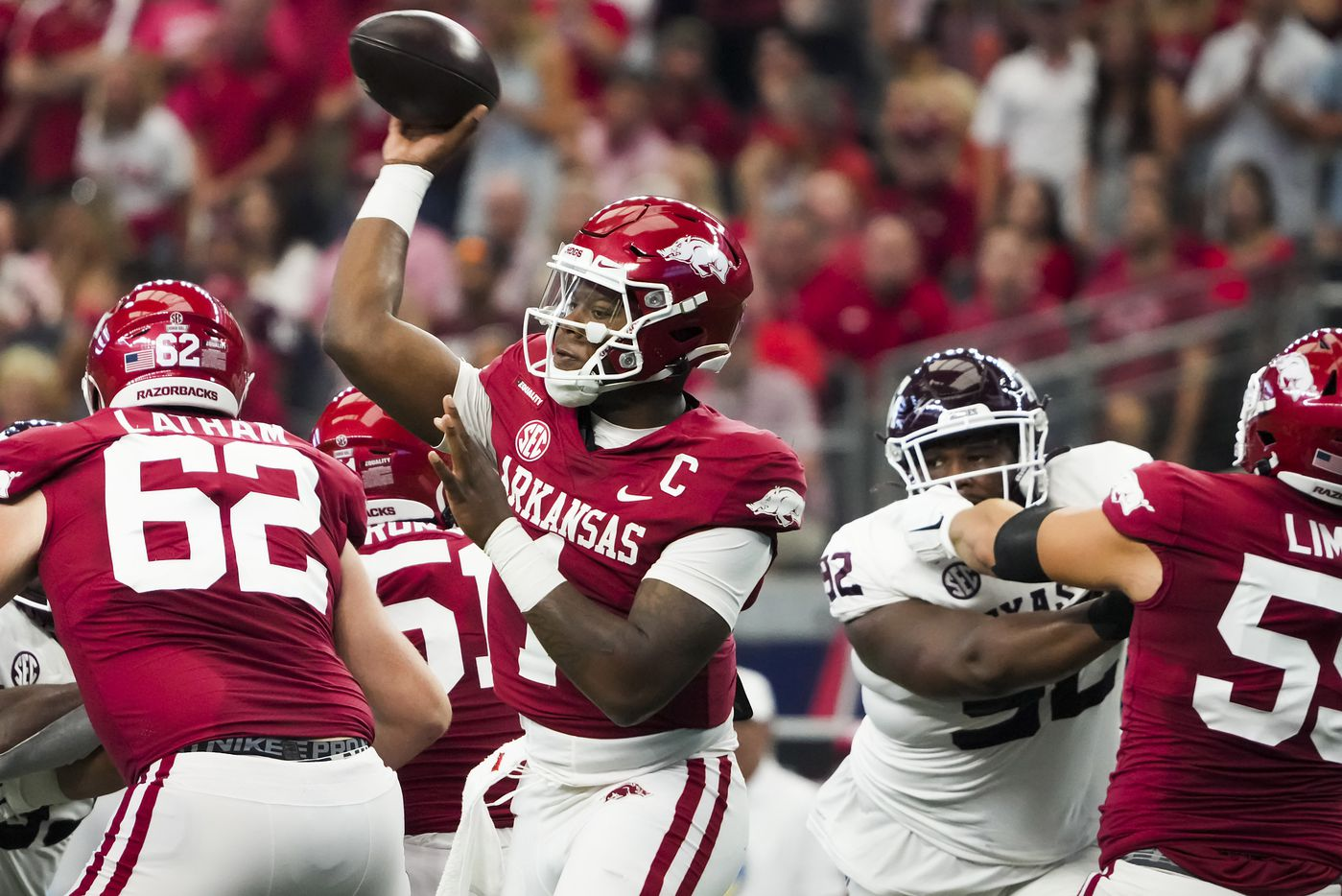 Arkansas quarterback KJ Jefferson (1) throws a pass under pressure from Texas A&M defensive lineman Jayden Peevy (92) during the first half of an NCAA football game at AT&T Stadium on Saturday, Sept. 25, 2021, in Arlington.