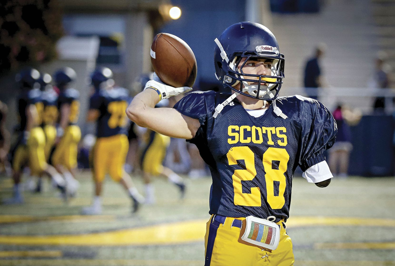 Cole Jackson warmed up before the Highland Park football game against West Mesquite on Oct. 6 in Highland Park. Jackson, a running back on the junior varsity team, lost most of his left arm two years ago after an accident on an all-terrain vehicle.