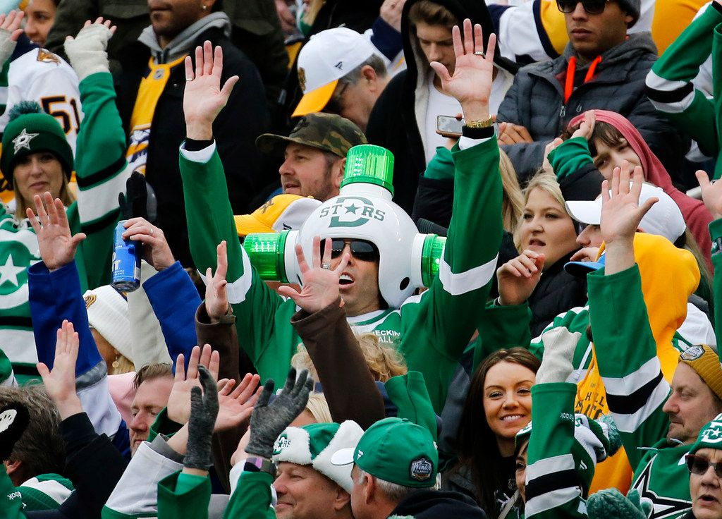 Dallas Stars fan Gregg Wilson (center) dons his green flashing helmet lights during the third period of the NHL Winter Classic hockey game at the Cotton Bowl in Dallas, Wednesday, January 1, 2020. The Dallas Stars came back to beat the Nashville Predators, 4-2. (Tom Fox/The Dallas Morning News)