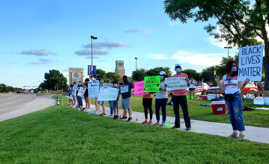 Residents gather alongside Long Prairie Road in Flower Mound on Thursday, June 4, 2020, to support racial equality and decry police brutality. It was the seventh straight day of demonstrations at the corner for an effort that began organically after a local mom's conversation with her daughter about the death of George Floyd.