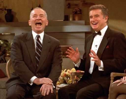 Ross Perot, left, showed off his patented laugh with Regis Philbin on 'Live With Regis and Kathie Lee' in 1999.