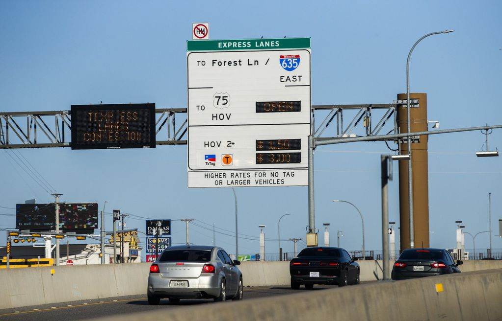 Vehicles pass a sign for Interstate 635 Express toll road near Forest Lane on Thursday, March 5, 2020 in Dallas.