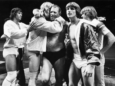 Fritz (center), the father of the Von Erich family of wrestling, including sons Kerry (far left), Kevin (second from right), David, Michael and Chris (two of whom are shown here).