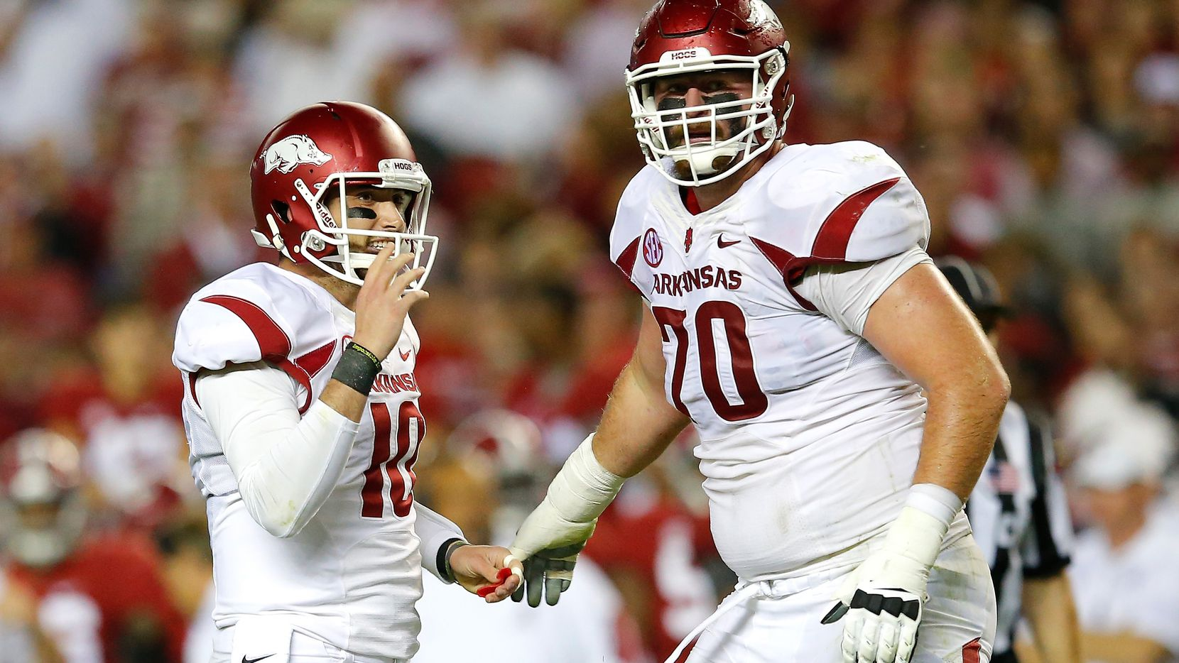TUSCALOOSA, AL - OCTOBER 10:  Brandon Allen #10 of the Arkansas Razorbacks reacts after passing for a touchdown against the Alabama Crimson Tide with Dan Skipper #70 at Bryant-Denny Stadium on October 10, 2015 in Tuscaloosa, Alabama.  (Photo by Kevin C. Cox/Getty Images)