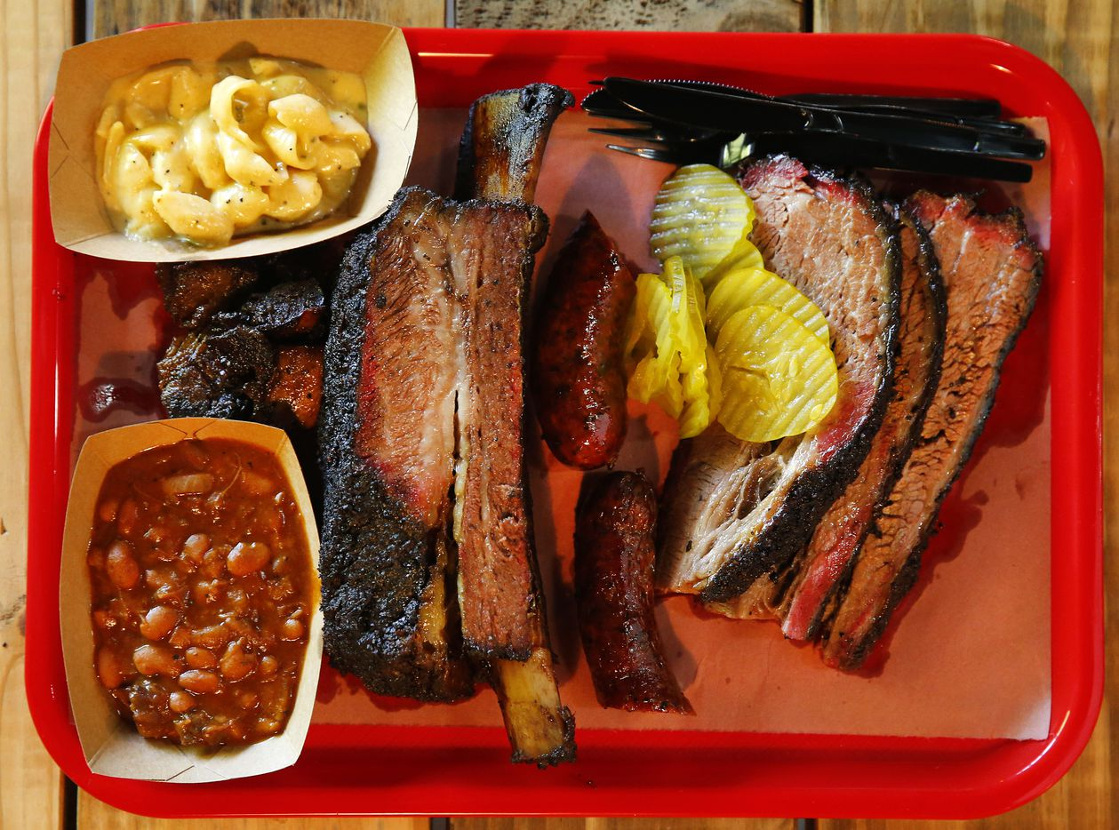 A tray full of burnt ends, brisket, beef rib, Texan spicy sausage, Italian sausage, burnt ends beans and mac & cheese. Owners Todd and Misty David reopened Cattleack Barbeque restaurant, Thursday, July 7, 2016, after doubling the size of their location at 13628 Gamma Rd. in North Dallas. (Tom Fox/The Dallas Morning News)