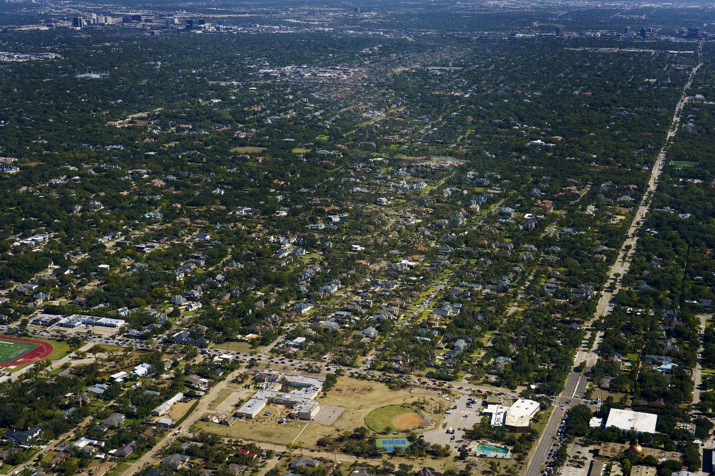 The path of tornado damage is seen stretching northeast from the Walnut Hill Recreation Center (bottom) on Monday, Oct. 21, 2019, in Dallas.