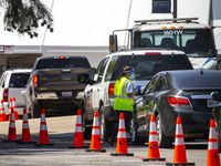 Personnel check-in visitors to the drive-thru COVID-19 testing site located at the University of Dallas campus in Dallas on Friday, July 10, 2020.