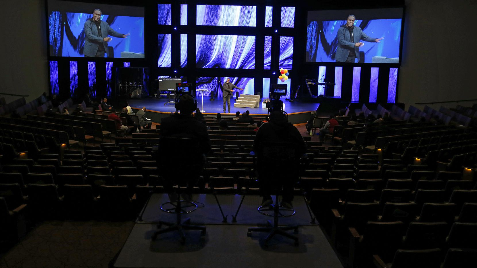 """One Community Church is a 10,000-member megachurch with campuses in Dallas, Lewisville, Plano and Prosper. But there was nothing """"mega"""" about attendance at the Plano campus on Sunday as the church's lead pastor, Conway Edwards, preached before a small group of congregational leaders during a service that was live-streamed for worshippers."""
