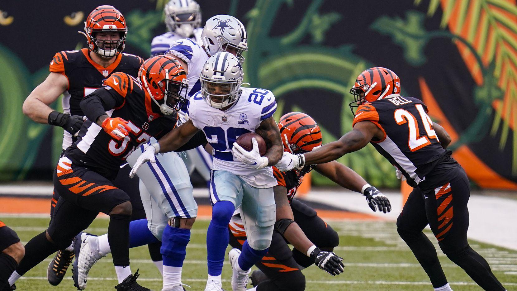 Dallas Cowboys running back Tony Pollard (20) runs against the Cincinnati Bengals in the second half of an NFL football game in Cincinnati, Sunday, Dec. 13, 2020. (AP Photo/Bryan Woolston)