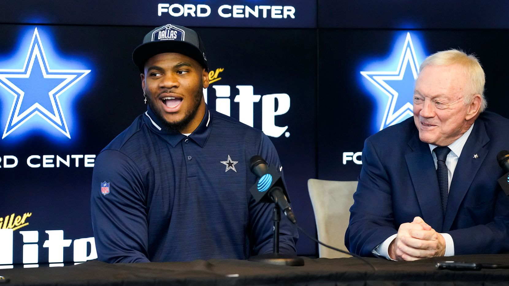 Dallas Cowboys first-round draft pick Micah Parsons (left) laughs with team owner Jerry Jones during a press conference introducing the linebacker from Penn State at The Star on Friday, April 30, 2021, in Frisco.