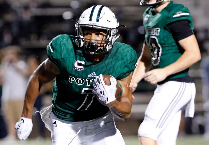 Mesquite Poteet RB Seth McGowan gets a handoff for a first down from QB Dalton Dale (10) during the first half of a high school football game against Waxahachie at Memorial Stadium in Mesquite, Thursday, September 6, 2018. Poteet won the game 48-7.