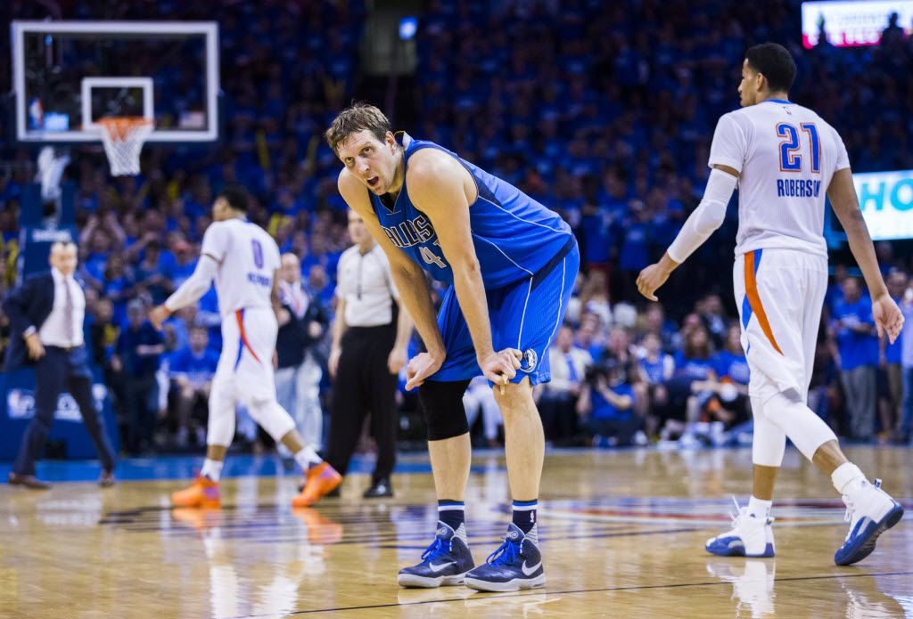 Dallas Mavericks forward Dirk Nowitzki (41) takes a rest during a timeout in the fourth quarter of game 5 of their series against the Oklahoma City Thunder in the first round of NBA playoffs on Monday, April 25, 2016 at Chesapeake Energy Arena in Oklahoma City, Oklahoma.  (Ashley Landis/The Dallas Morning News)