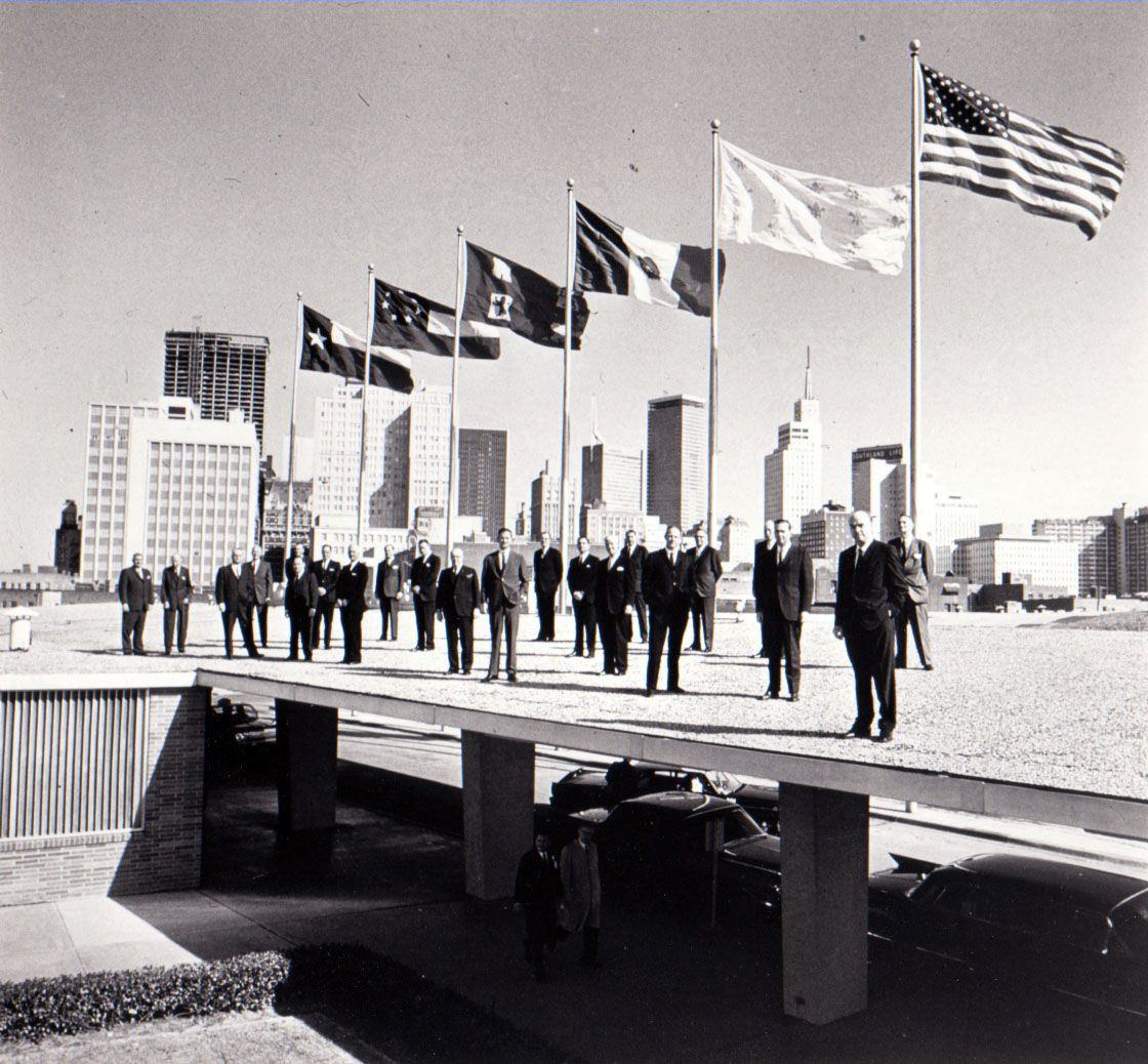 This photo ran in Fortune in 1964. The board of directors of the Dallas Citizens Council broke with a tradition of behind-the-scenes anonymity to pose for this picture atop the Memorial Auditorium. The are, from left: C.A. Tatum Jr., Dallas Power & Light; Karl Hoblitzelle, Interstate Theatres; Dan C. Williams, Southland Life Insurance; Raymond H. Cummins, Sanger-Harris Department Store; Robert B. Cullum, Tom Thumb stores; James W. Aston, Republic National Bank; W. W. Overton Jr., Texas Bank and Trust; Robert E. Kepke, British American Oil; W. Dow Hamm,  Atlantic Refining; T. E. Jackson, investments; John M. Stemmons, Industrial Properties; Charles A. Meyer, Sears, Roebuck; Avery Mays, Casa View Village; Robert H. Stewart III, First National Bank; Robert McCulloch, Ling-Temco-Vought; John Lawrence, Dresser Industries; William L. Lindholm, Southwestern Bell; Lloyd Bowles, Dallas Federal Savings & Loan; Walter L. Prehn; Dawson Sterling, Southwestern Life; Julius Schepps, Schepps; and Mayor J. Erik Jonsson, Texas Instruments.  Seven members of the board were away at the time.