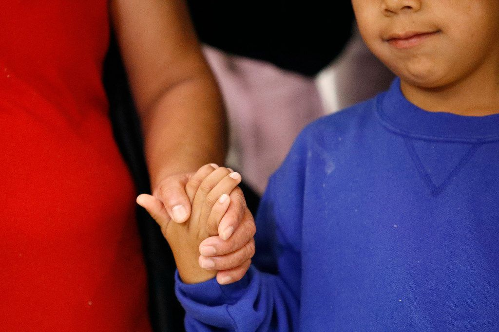 Darwin Micheal Mejia, right, holds hands with his mother, Beata Mariana de Jesus Mejia-Mejia, during a news conference following their reunion at Baltimore-Washington International Thurgood Marshall Airport, Friday, June 22, 2018, in Linthicum, Md. The Justice Department agreed to release Mejia-Mejia's son after she sued the U.S. government in order to be reunited following their separation at the U.S. border. She has filed for asylum in the U.S. following a trek from Guatemala.