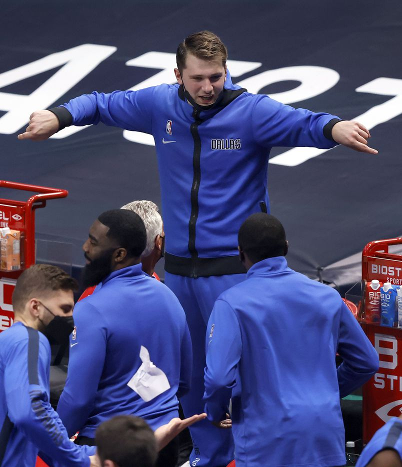 Dallas Mavericks guard Luka Doncic (77) dances to the music in his seat during a fourth quarter timeout against the Cleveland Cavaliers at the American Airlines Center in Dallas, Friday, May 7, 2021. (Tom Fox/The Dallas Morning News)
