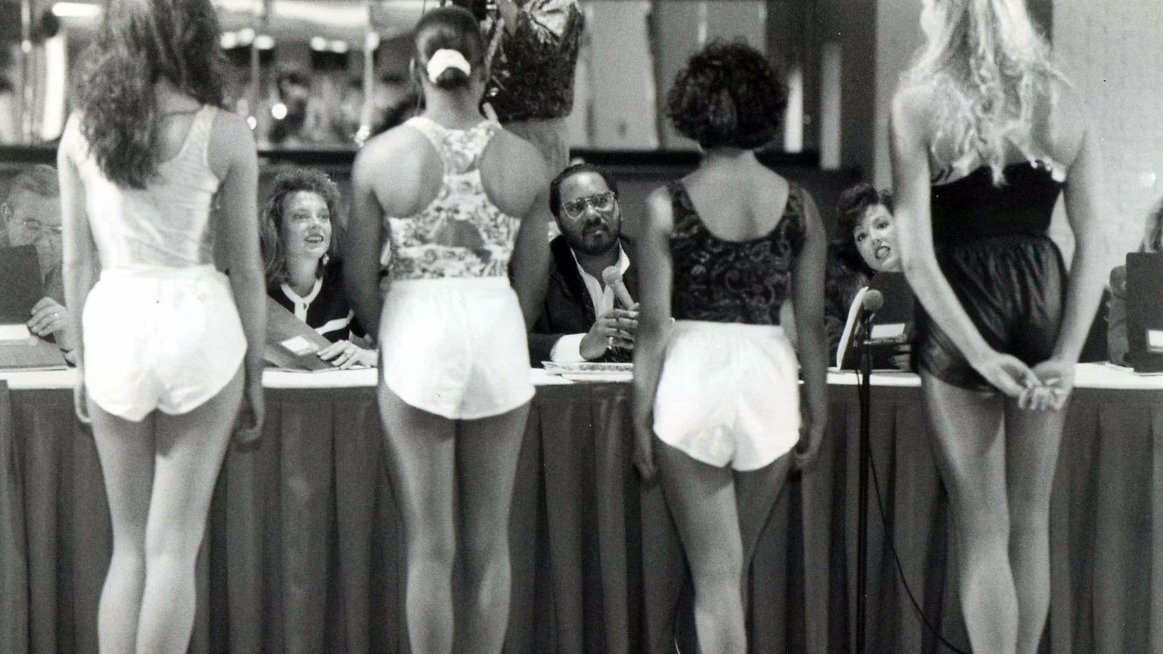 Former KVIL disc jockey Scott West, center, judges Dallas Cowboy Cheerleader tryouts in 1993 with, from left, Buddy Sharp, hairstylist for the Dallas Cowboys Cheerleaders; Charlotte Anderson, Marketing Director for the Cowboys; West; and Kelli McGonagill, director of the Cheerleaders.