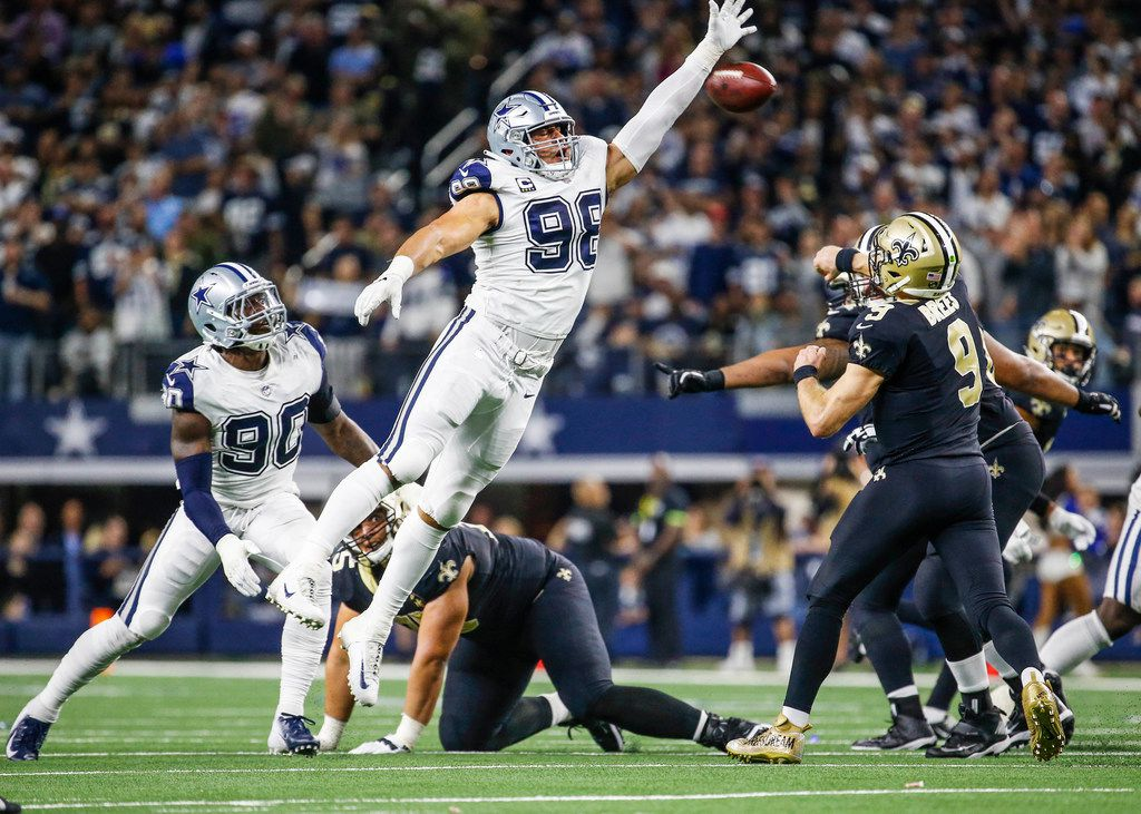 Dallas Cowboys defensive tackle Tyrone Crawford (98) attempts to block the ball during the second half of the NFL football game between the Dallas Cowboys and the New Orleans Saints on Thursday, Nov. 29, 2018 in Arlington, Texas.