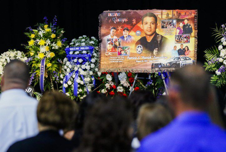 Photos are displayed during a funeral service for Dallas police officer Patrick Zamarripa on Saturday, July 16, 2016 at Wilkerson-Greines Athletic Center in Fort Worth, Texas.