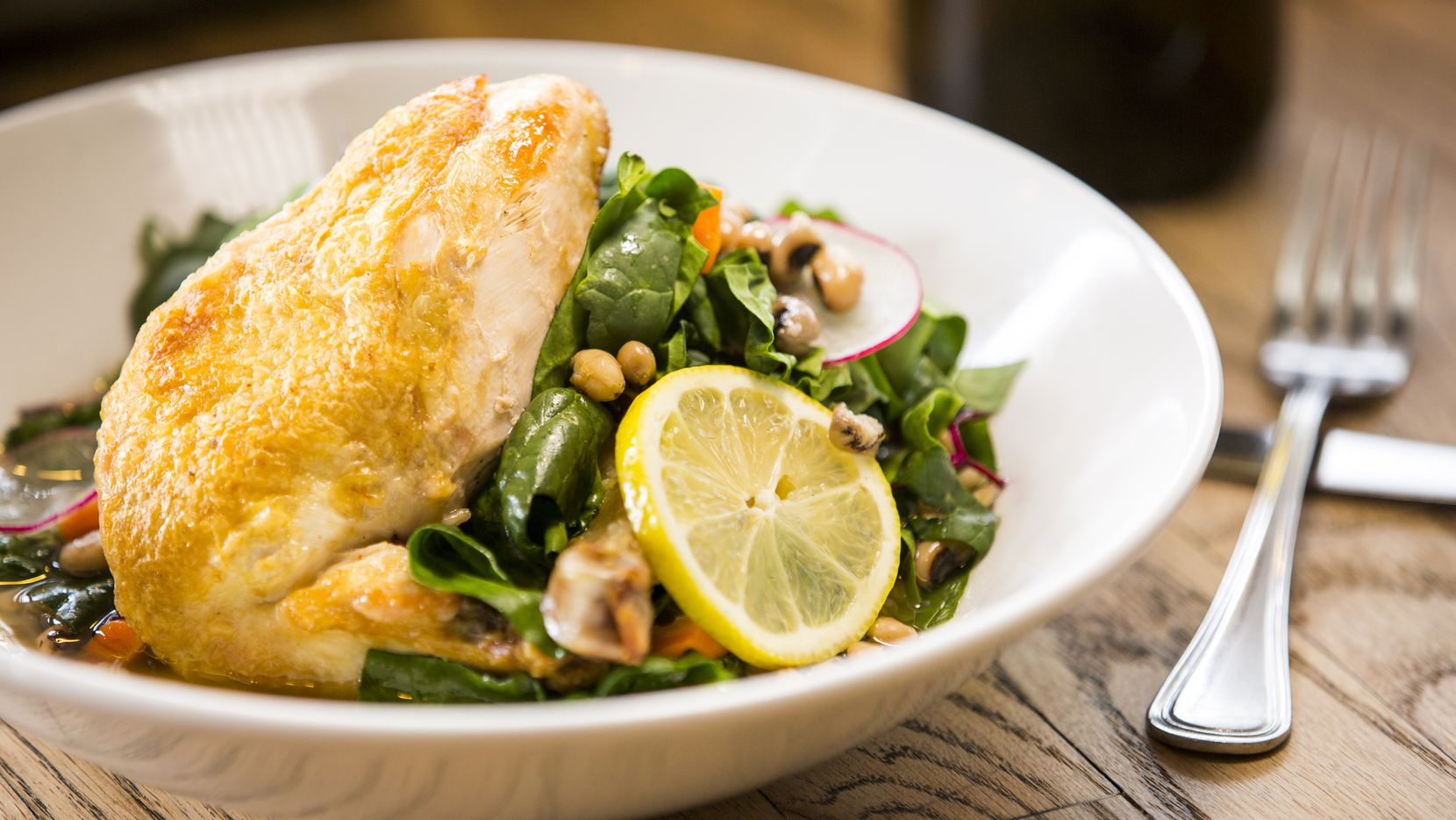 Roast chicken with greens and radishes by Andrea Shackelford at Harvest