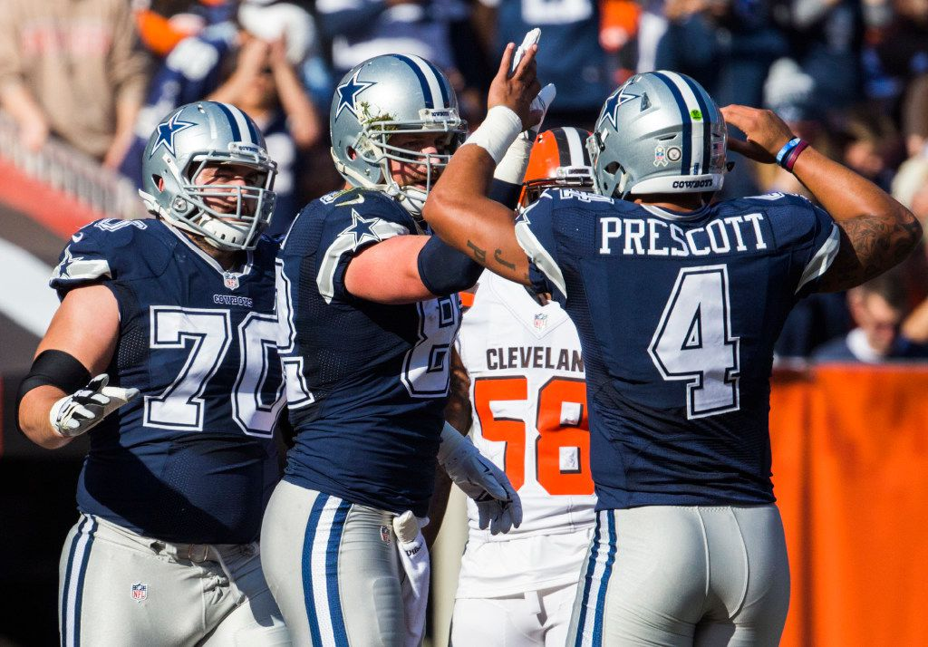 Dallas Cowboys tight end Jason Witten (82) celebrates a touchdown with quarterback Dak Prescott (4) and guard Zack Martin (70)  during the first quarter of their game against the Cleveland Browns on Sunday, November 6, 2016 at FirstEnergy Stadium in Cleveland, Ohio.  (Ashley Landis/The Dallas Morning News)