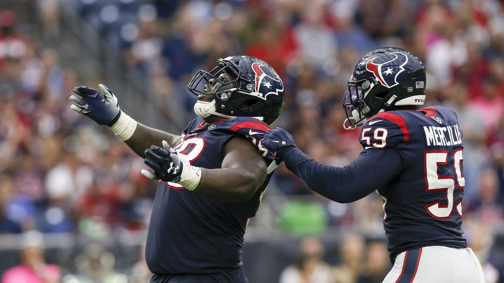 HOUSTON - OCT. 6:  D.J. Reader #98 of the Texans celebrates with Whitney Mercilus #59 after a sack in the second half of a game against the Atlanta Falcons at NRG Stadium on Oct. 6, 2019, in Houston.