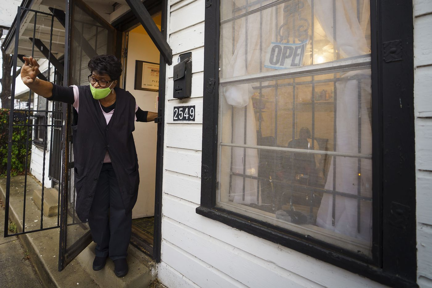 Earnestine Tarrant waves goodbye to a client at her hair salon in South Dallas. Tarrant opened her beauty salon in a tiny house on a corner in 1979. After four decades in business, she decided to close on New Year's Eve 2020.