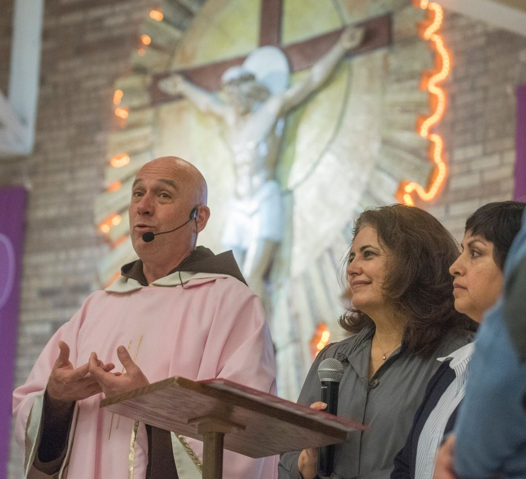 Frair Luis Gerardo Arraiza of Our Lady of Lourdes Catholic Church encourages church members to apply for citizenship while standing next to Socorro Perales, center, and Xochi Guerra, second from right, from Dallas Area Interfaith after services on Sunday, Dec. 17, 2017.   (Rex C. Curry/Special Contributor)