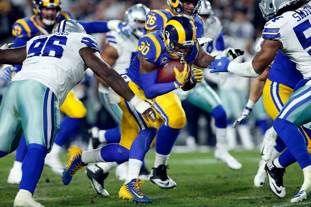 Los Angeles Rams running back Todd Gurley (30) carries the ball against the Dallas Cowboys defense during the second quarter of their NFC Divisional Playoff game at Los Angeles Memorial Coliseum in Los Angeles, Saturday, January 12, 2019. (Tom Fox/The Dallas Morning News)