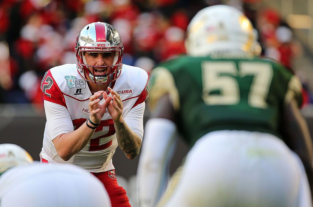 MIAMI, FL - DECEMBER 21:  Brandon Doughty #12 of the Western Kentucky Hilltoppers calls a play during the 2015 Miami Beach Bowl against the South Florida Bulls at Marlins Park on December 21, 2015 in Miami, Florida.  (Photo by Mike Ehrmann/Getty Images)