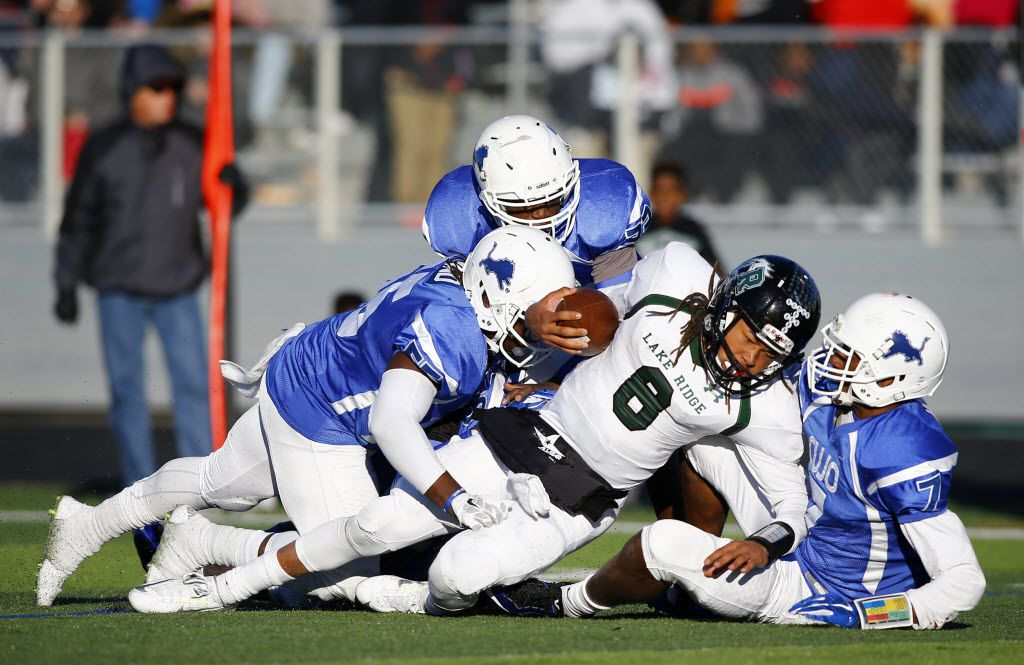 TXHSFB Mansfield Lake Ridge's Jett Duffey (8) is tackled by Tyler John Tyler's Decorian Blaylock (55) and Brandon Dade (7) in the second half of their 5A-DI Region 2 area high school football playoff game in Forney, Texas, Saturday, November 21, 2015. Mike Stone/Special Contributor