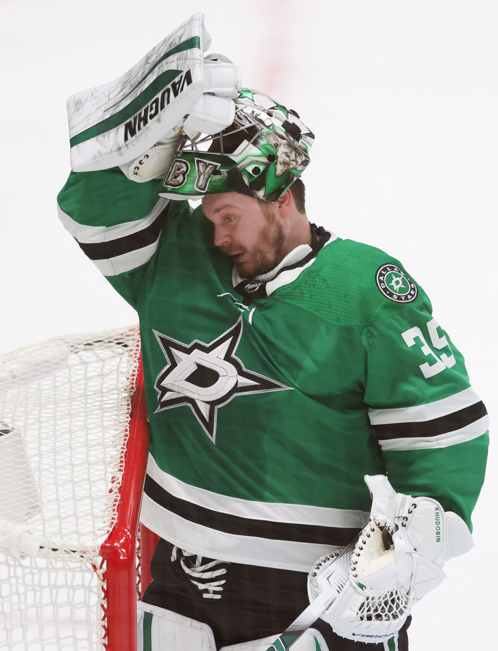 Dallas Stars goaltender Anton Khudobin (35) puts his mask back on in a game against the Nashville Predators during the first period of play in the Stars home opener at American Airlines Center on Friday, January 22, 2021in Dallas. (Vernon Bryant/The Dallas Morning News)