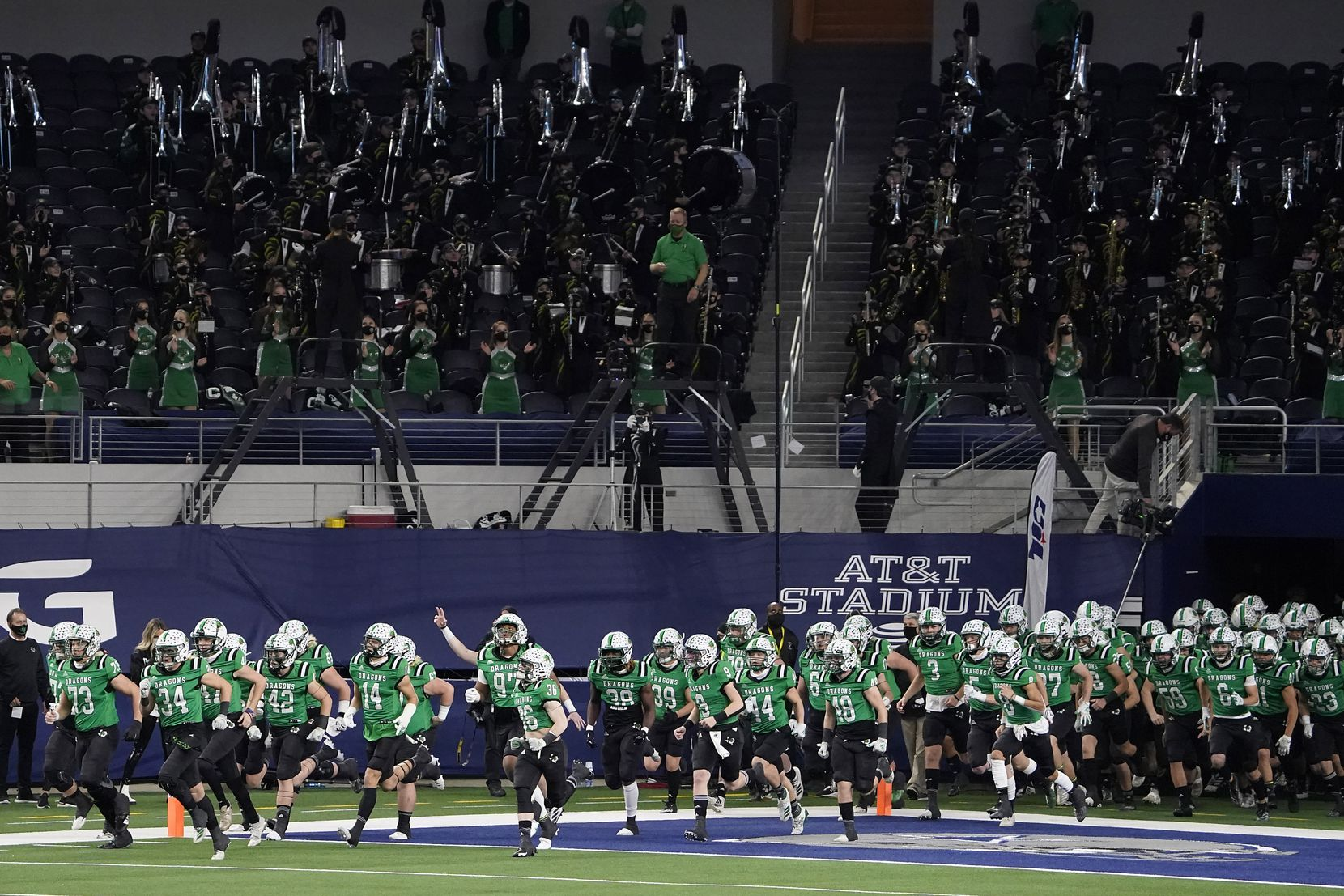 The Southlake Carroll Dragons take the field to face Austin Westlake in the Class 6A Division I state football championship game at AT&T Stadium on Saturday, Jan. 16, 2021, in Arlington, Texas.