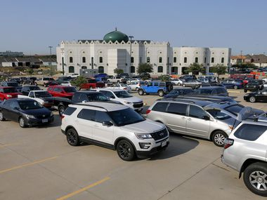 Dozens of cars waited in line during a food bank distribution Thursday at the Islamic Center of Irving.