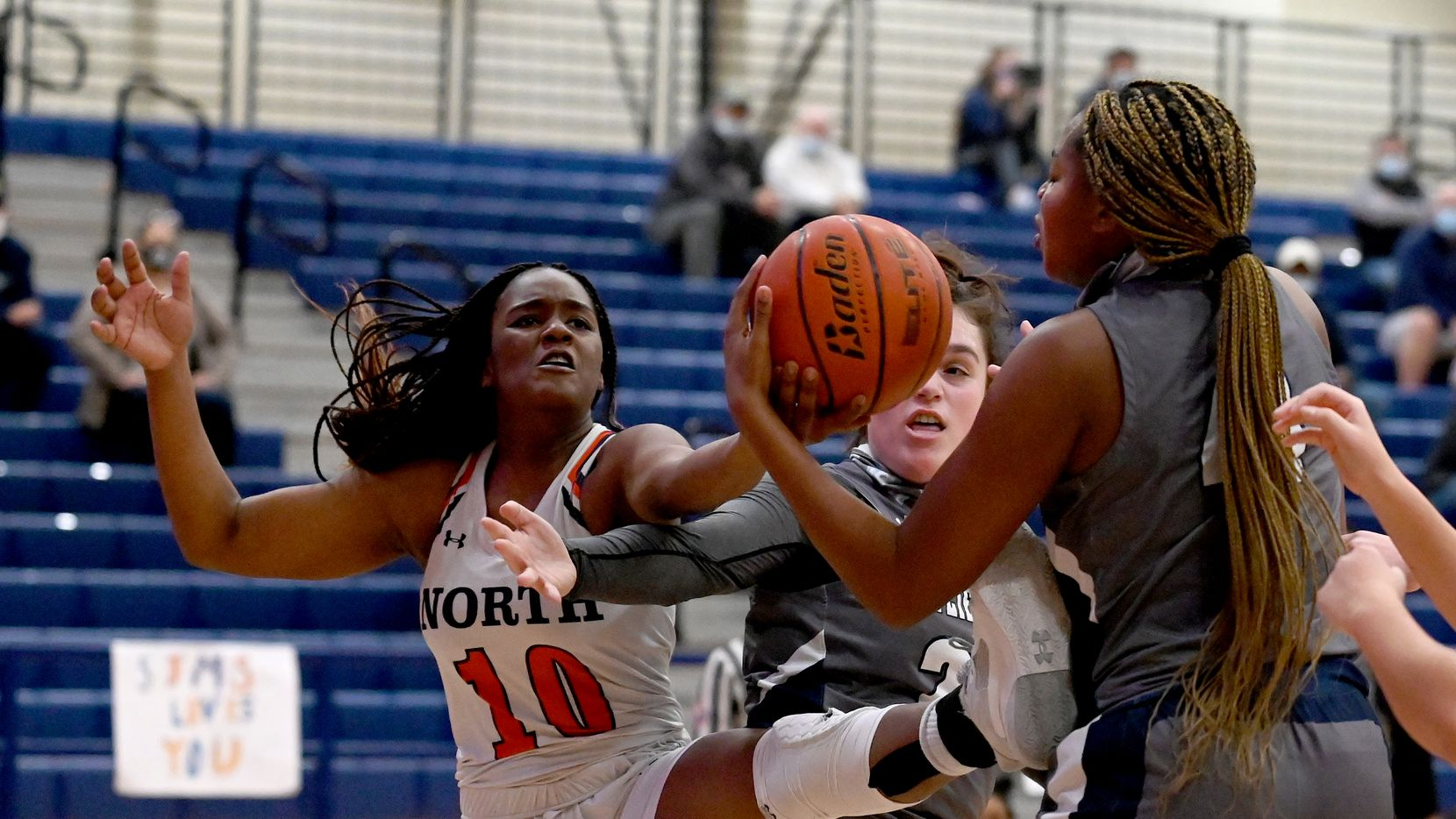 McKinney North's Kaelyn Hamilton (10) goes after a rebound with Wylie East's Kiley Hicks, center, and Akasha Davis in the first half during a girls basketball game between Wylie East and McKinney North, Tuesday, Feb. 2, 2020, in McKinney, Texas.