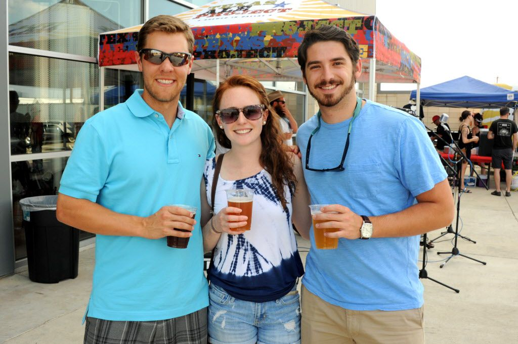 Eugene Mumford, Samantha Lee, and David Brady enjoy brews, music, and cars at the custom car show at Texas Ale Project in Dallas, TX on August 15, 2015.