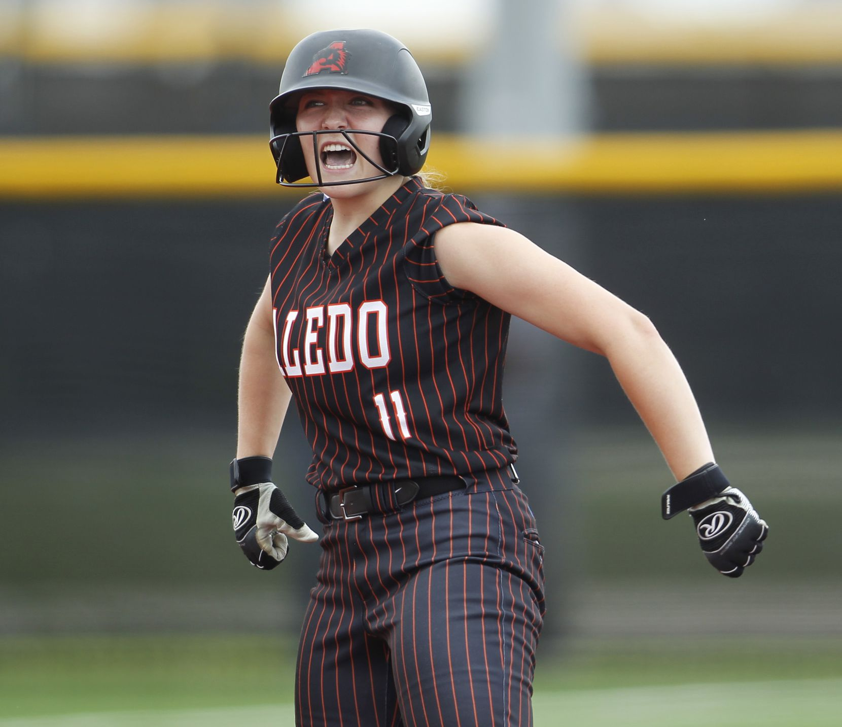 Aledo outfielder Marissa Powell (11) lets out a yell after reaching second base on a double during the top of the first inning of play against Georgetown.  The two teams played their UIL 5A state softball semifinal game at Leander Glenn High School in Leander on June 4, 2021. (Steve Hamm/ Special Contributor)