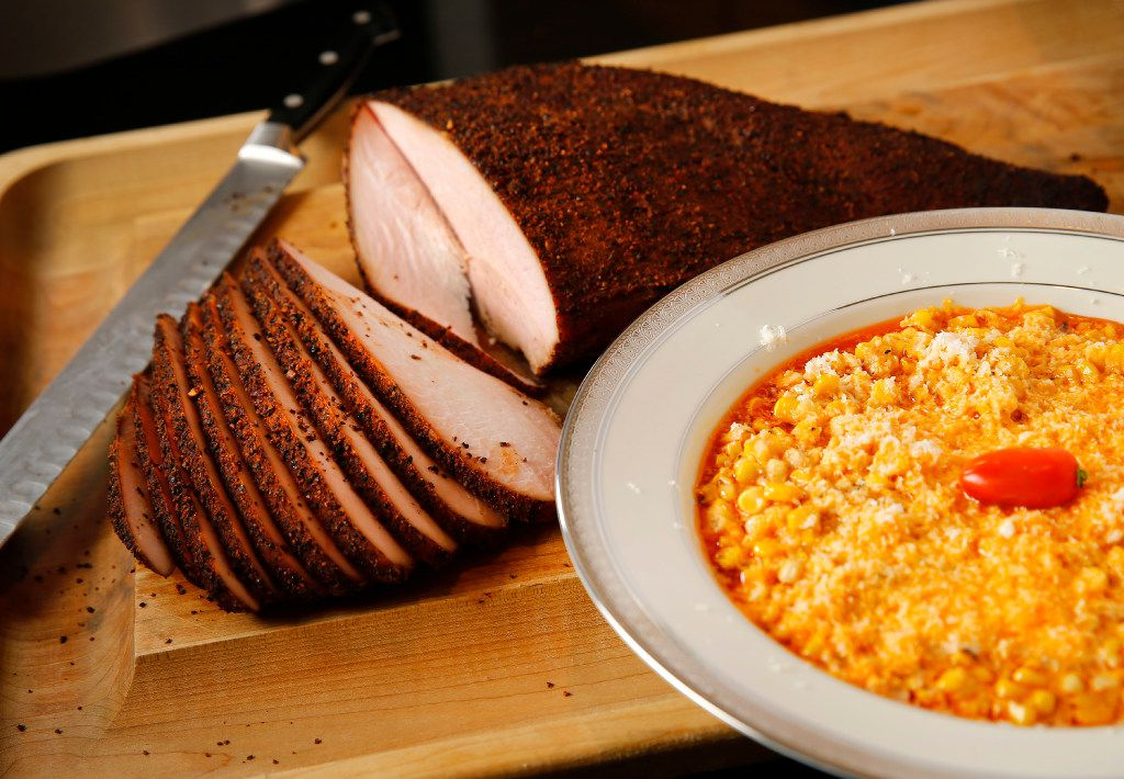 Cattleack Barbecue pitmaster Todd David displays his cheesy chipotle corn (right) and smoked turkey breast, a personal Thanksgiving favorite at his Plano, Texas home Wednesday, November 2, 2016. Todd bases his recipe on the Fuel City corn they serve, with extra chipotle. The turkey rub is similar to his pork rub which contains about 20 spices. For Thanksgiving, he is smoking whole turkey breast at Cattleack to go. (Tom Fox/The Dallas Morning News)